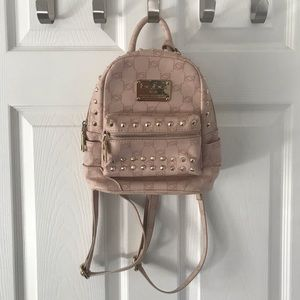 Bebe Soft Punk and Gold studded small backpack